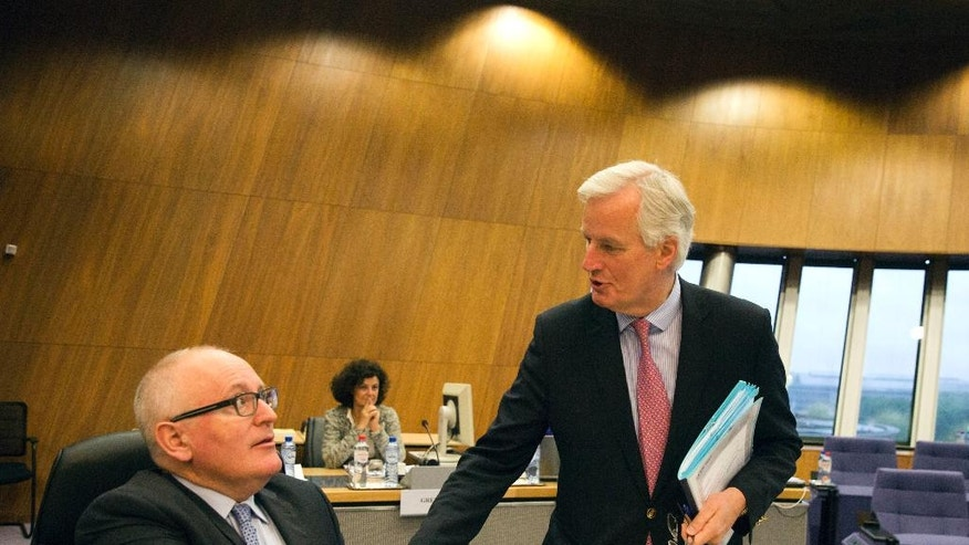 European Union chief Brexit negotiator Michel Barnier, right, greets European Commission Vice-President Frans Timmermans during a weekly EU Commission meeting at EU headquarters in Brussels on Wednesday, May 3, 2017. The EU's chief Brexit negotiator, Michel Barnier, will speak to the media in Brussels on Wednesday regarding Britain's departure from the bloc, after he presents his draft mandate laying out the terms for the talks. (AP Photo/Virginia Mayo)