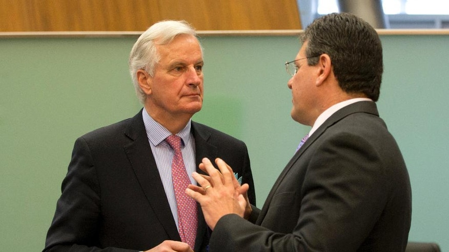 European Union chief Brexit negotiator Michel Barnier, left, speaks with European Commissioner for Energy Union Maros Sefcovic during a weekly EU Commission meeting at EU headquarters in Brussels on Wednesday, May 3, 2017. The EU's chief Brexit negotiator, Michel Barnier, will speak to the media in Brussels on Wednesday regarding Britain's departure from the bloc, after he presents his draft mandate laying out the terms for the talks. (AP Photo/Virginia Mayo)