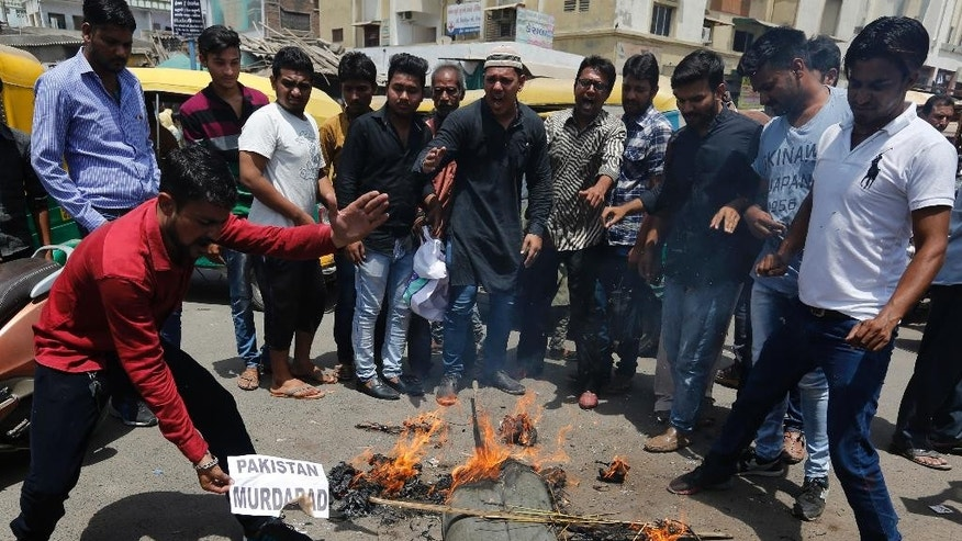 Indians burn an effigy of Pakistan and shout anti-Pakistan slogans during a protest in Ahmadabad, India, Wednesday, May 3, 2017. Two Indian soldiers were killed and their bodies mutilated Monday in an ambush by Pakistani soldiers along the highly militarized de facto border that divides the disputed region of Kashmir between the nuclear-armed rivals, the Indian army said. But Pakistan denied any such attack, calling the Indian claims false. (AP Photo/Ajit Solanki)