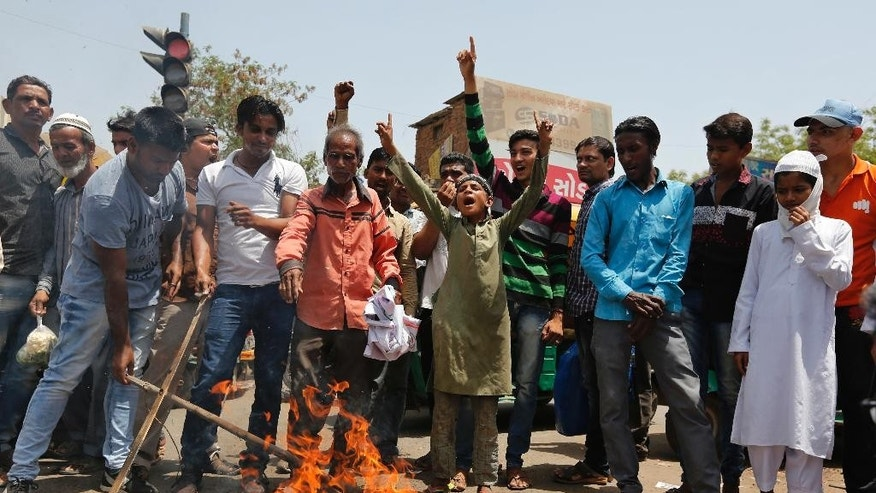 Indian burn an effigy of Pakistan and shout anti-Pakistan slogans during a protest in Ahmadabad, India, Wednesday, May 3, 2017. Two Indian soldiers were killed and their bodies mutilated Monday in an ambush by Pakistani soldiers along the highly militarized de facto border that divides the disputed region of Kashmir between the nuclear-armed rivals, the Indian army said. But Pakistan denied any such attack, calling the Indian claims false. (AP Photo/Ajit Solanki)