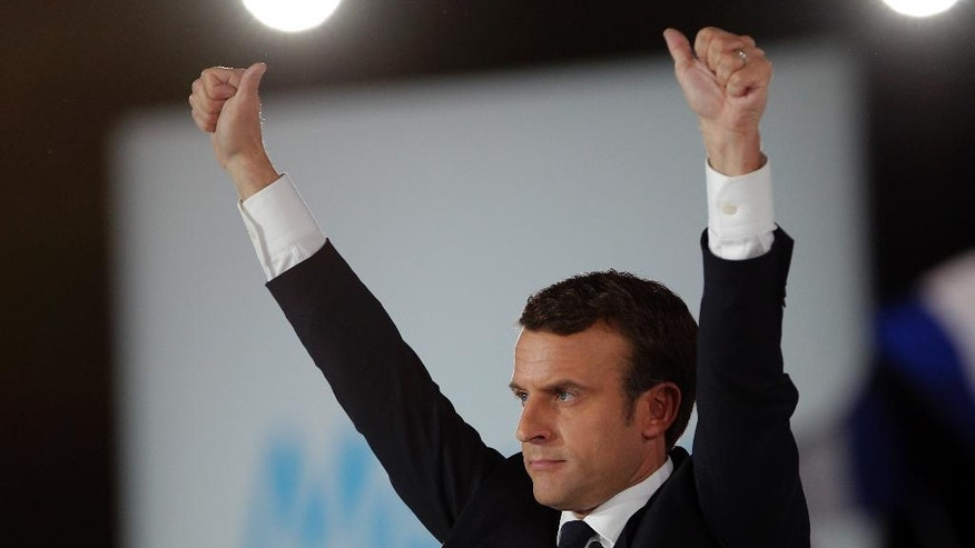 French independent centrist presidential candidate Emmanuel Macron waves to his supporters during a campaign rally in Paris, France, Monday, May 1st, 2017. With just six days until a French presidential vote that could define Europe's future, far-right leader Marine Le Pen and centrist Emmanuel Macron are holding high-stakes rallies Monday. (AP Photo/Christophe Ena)