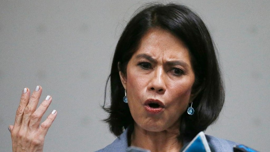 Acting Environment and Natural Resources Secretary Gina Lopez gestures during a news conference following the rejection of her appointment as a cabinet member by the Commission on Appointments based on the recommendation of its committee on environment and natural resources, headed by Sen. Manny Pacquiao Wednesday, May 3, 2017, in Pasay city south of Manila, Philippines. Lopez, whose family owns the country's largest television network, was the second cabinet member to be rejected by a majority of the members of the commission under President Rodrigo Duterte. Lopez ordered the closure and suspension of dozens of mines she says harm the environment and residents.(AP Photo/Bullit Marquez)