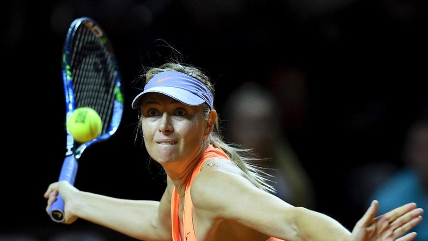 Russian tennis player Maria Sharapova returns the ball to Kristina Mladenovic from France during the Porsche Tennis Grand Prix in Stuttgart, Germany, Saturday, April 29, 2017. (Bernd Weissbrod/dpa via AP)