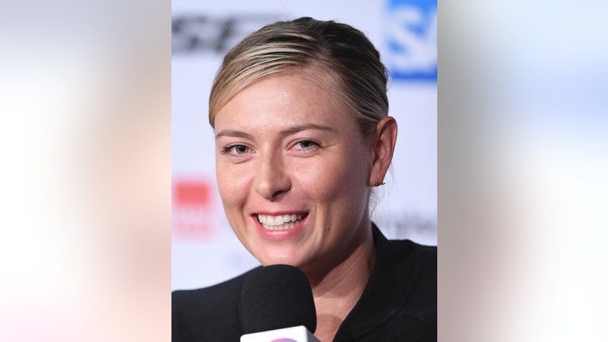 Russian tennis player Maria Sharapova smiles at a news conference at the WTA tennis tournament in the Porsche Arena in Stuttgart, Germany, Friday, April 28, 2017. (Bernd Weissbrod/dpa via AP)
