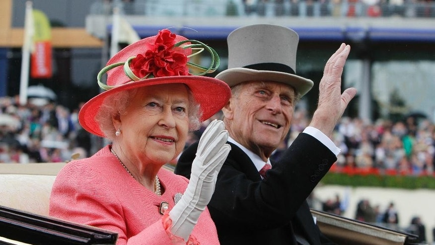 FILE - In this Thursday, June, 16, 2011 file photo Britain's Queen Elizabeth II with Prince Philip arrive by horse drawn carriage in the parade ring on the third day, traditionally known as Ladies Day, of the Royal Ascot horse race meeting at Ascot, England. Queen Elizabeth II's husband, Prince Philip, will stop carrying out public engagements this fall, Buckingham Palace announced Thursday May 4, 2017. (AP Photo/Alastair Grant, File)
