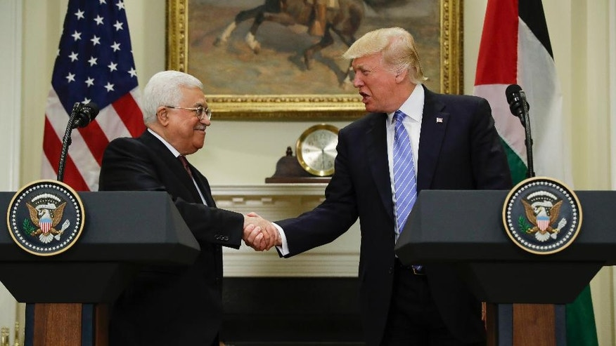 President Donald Trump shakes hands with Palestinian leader Mahmoud Abbas after their statements in the Roosevelt Room of the White House in Washington, Wednesday, May 3, 2017. (AP Photo/Evan Vucci)