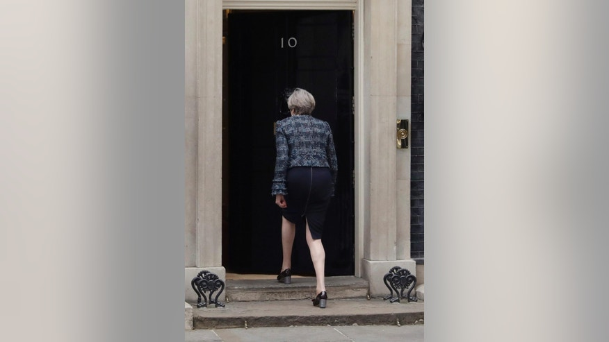 British Prime Minister Theresa May enters 10 Downing Street after addressing the media following her visiting Queen Elizabeth II at Buckingham Palace, in London where she asked for the dissolution of Parliament ahead of the upcoming general election, Wednesday, May 3, 2017.(AP Photo/Matt Dunham)