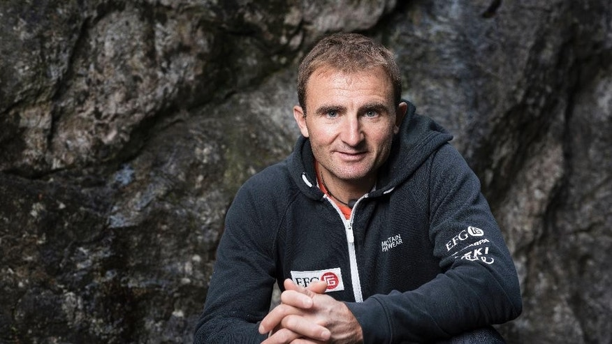 FILE - In this Sept. 11, 2015 file photo Swiss climber Ueli Steck poses for a photo at the foot of a climbing wall in Wilderswil, Canton of Berne, Switzerland. Expedition organizers say famed Swiss climber Ueli Steck was killed in a mountaineering accident near Mount Everest in Nepal. (Christian Beutler/Keystone via AP)