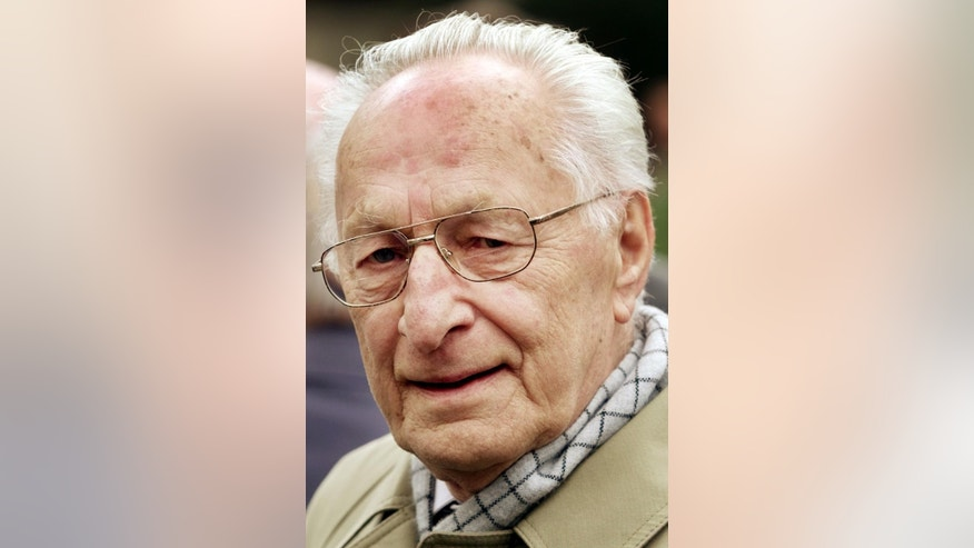 FILE - The April 18, 2002 file photo shows the last defense minister of the GDR Heinz Kessler as he attends the funeral of the wife of GDR founder Walter Ulbricht, Lotte Ulbricht in Berlin. Kessler who was convicted of manslaughter for upholding the shoot-to-kill order at the communist country's border, has died. He was 97. (AP Photo/Herbert Knosowski, file)