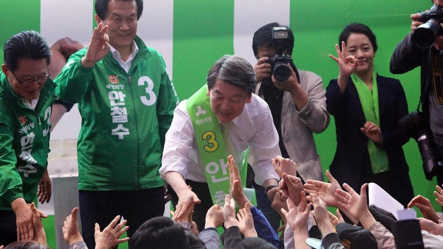 FILE - In this Sunday, April 30, 2017 file photo, Ahn Cheol-soo, center, presidential candidate of South Korea's People's Party, is greeted by his supporters during a presidential election campaign in Goyang, South Korea. For South Koreans living next door to a hostile, nuclear-armed state that regularly threatens their annihilation, their vote in Tuesday's presidential election likely will be based in part on each candidate's plan for how to handle North Korea. The North Korea conundrum is a perpetual foreign policy headache for South Korea's leaders and one that is impacting the presidential race in several ways.  (AP Photo/Ahn Young-joon, File)