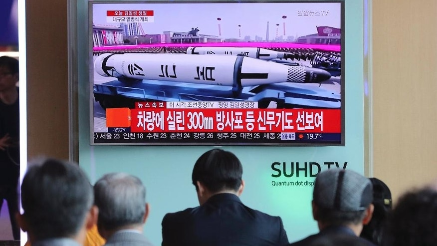 "FILE - In this Saturday, April 15, 2017 file photo, people watch a live television program showing North Korea's missiles with letters reading ""Pukguksong,"" or Polaris, during a parade in Pyongyang, North Korea, at the Seoul train station in Seoul, South Korea. For South Koreans living next door to a hostile, nuclear-armed state that regularly threatens their annihilation, their vote in Tuesday's presidential election likely will be based in part on each candidate's plan for how to handle North Korea. The North Korea conundrum is a perpetual foreign policy headache for South Korea's leaders and one that is impacting the presidential race in several ways. (AP Photo/Lee Jin-man, File)"