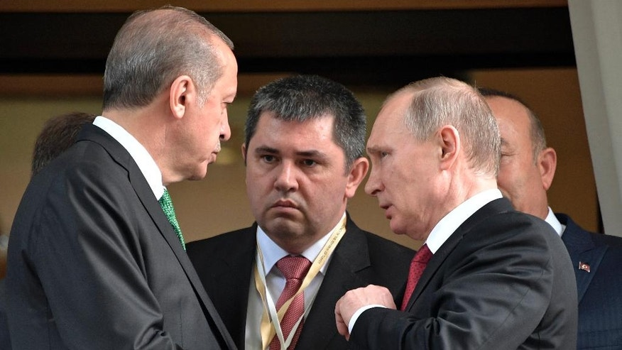 Turkish President Recep Tayyip Erdogan, left, speaks to Russian President Vladimir Putin, right, as he leaves after their meeting in Putin's residence in the Russian Black Sea resort of Sochi, Russia, Wednesday, May 3, 2017. The presidents of Russia and Turkey held talks on the situation in Syria and also the restoration of full economic ties between their two countries. (Alexei Nikolsky/Sputnik, Kremlin Pool Photo via AP)