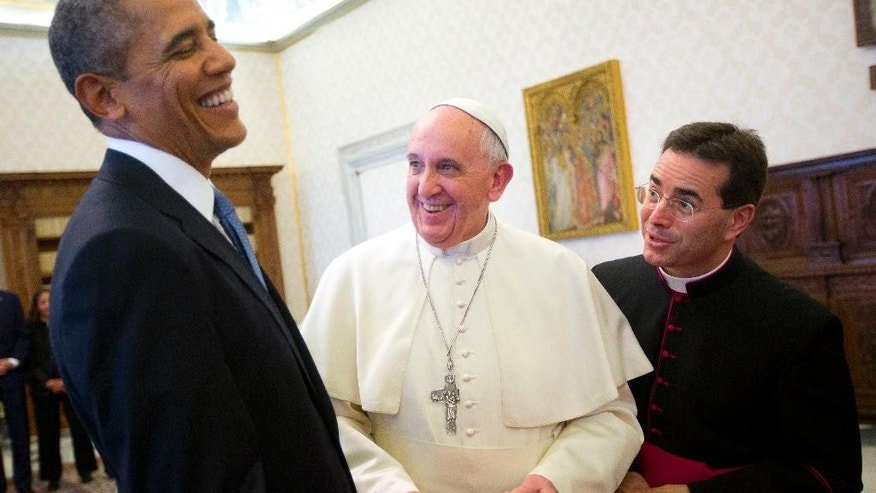 "FILE - In this Thursday, March 27, 2014 file photo, U.S. President Barack Obama, left, reacts as he meets with Pope Francis, center, during their exchange of gifts at the Vatican. When Pope Francis meets with President Donald Trump at the Vatican May 24, the world will be watching how the Argentine ""slum pope"" interacts with the brash, New York billionaire-turned-president. (AP Photo/Pablo Martinez Monsivais, File)"