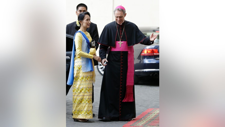 State Counsellor and Union Minister for Foreign Affairs of the Republic of the Union of Myanmar Aung San Suu Kyi, left, is welcomed by Prefect of the Pontifical Household, Archbishop Georg Ganswein, upon her arrival at the Vatican for a private audience with Pope Francis, Thursday, May 4, 2017. (AP Photo/Andrew Medichini)