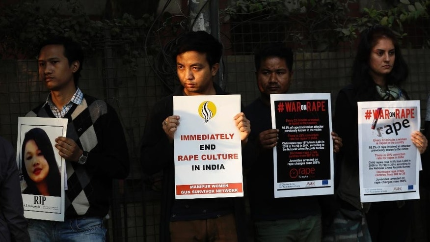 FILE - In this Feb. 21, 2017, file photo, Indians hold placards during a protest against an alleged rape in New Delhi, India. India's top court on Friday, May 8, 2017 upheld death sentences of four men who were convicted in the fatal gang-rape and torture of a 23-year-old medical student on a moving bus in the Indian capital nearly five years ago. The four had challenged a 2013 trial court ruling that they should be hanged, which was later upheld by an appeals court. (AP Photo/Tsering Topgyal, file)