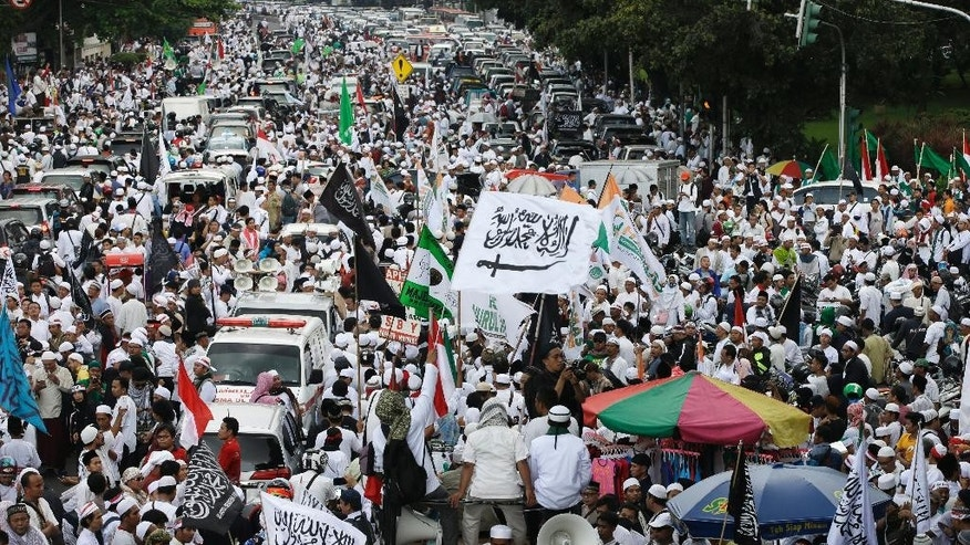 "Muslim protesters march during a protest against Jakarta's Christian Governor Basuki ""Ahok"" Tjahaja Purnama in Jakarta, Indonesia, Friday, May 5, 2017. Thousands of conservative Muslims took to the streets of the Indonesian capital to call for the jailing of the minority Christian governor who is on trial on charges of blaspheming the Quran. (AP Photo/Achmad Ibrahim)"