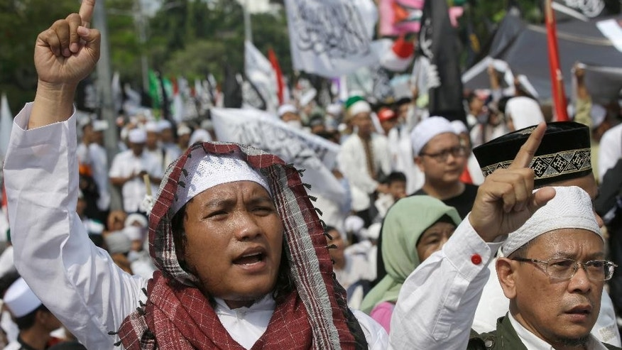 "Muslim protesters shout slogans during a protest against Jakarta's Christian Governor Basuki ""Ahok"" Tjahaja Purnama in Jakarta, Indonesia, Friday, May 5, 2017. Thousands of conservative Muslims took to the streets of the Indonesian capital to call for the jailing of its minority Christian governor who is on trial on charges of blaspheming the Quran. (AP Photo/Achmad Ibrahim)"
