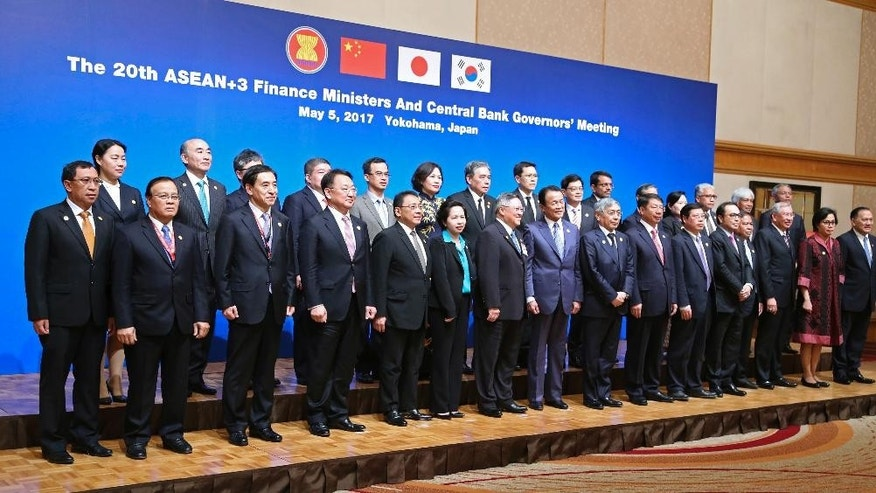 Finance ministers and governors pose as a group during their photo session of the ASEAN+3 (Association of Southeast Asian Nations) meeting in Yokohama, Friday, May 5, 2017. (AP Photo/Koji Sasahara)