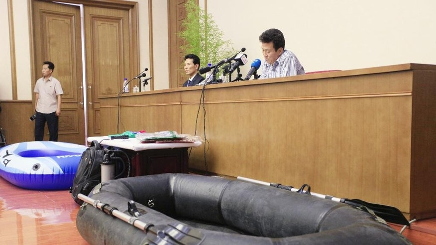 "FILE - In this July 15, 2016 file photo, Ko Hyon Chol, seated right, speaks to reporters in Pyongyang, North Korea, when North Korea presented Ko as a man it alleges is a South Korean spy who tried to enter the North to kidnap children. The detainee apologized for a crime he called ""unforgivable,"" although South Korea's National Intelligence Service said it had no relation to the case. North Korea often arranges news conferences for foreign detainees during which they read statements that purport to acknowledge their wrongdoing and praise the North's political system. (AP Photo/Jon Chol Jin, File)"