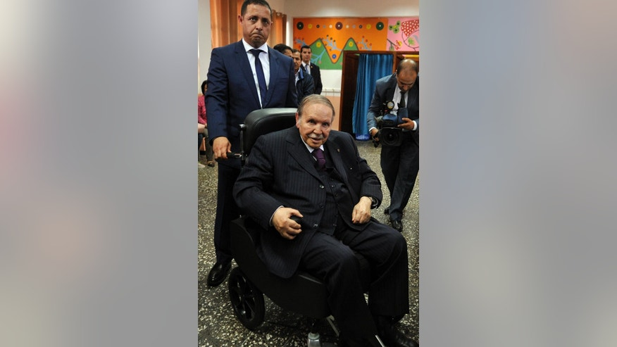 Algerian President Abdelaziz Bouteflika looks on after voting in Algiers, Thursday, May 4, 2017. Algerians vote Thursday in parliamentary elections the government hopes will give it a mandate as it struggles with low oil prices, dismal job prospects and Islamic extremism. (AP Photo/Sidali Djarboub)