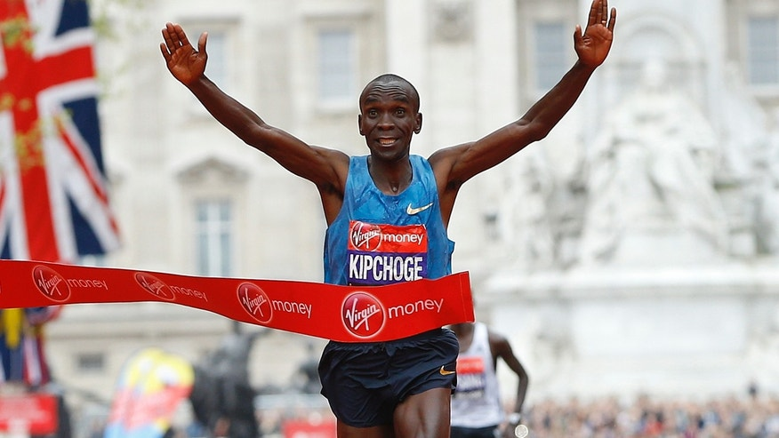In this Sunday, April 26, 2015 file photo, Eliud Kipchoge of Kenya wins the Men's race in the 35th London Marathon.