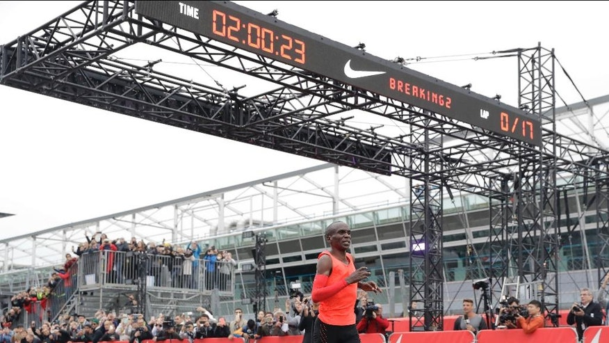 Olympic marathon champion Eliud Kipchoge crosses the finish line of a marathon race at the Monza Formula One racetrack, Italy, Saturday, May 6, 2017. Kipchoge was 26 seconds from making history on Saturday but in the end the Olympic champion was just short of becoming the first person to run a marathon in less than two hours. Kipchoge ran the 26.2 miles (42.2 kilometers) in 2 hours and 25 seconds, beating Dennis Kimetto's world record of 2:02:57, but the Kenyan failed to run the first sub-two hour marathon. (AP Photo/Luca Bruno)