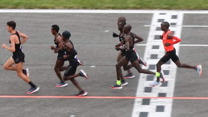 Athletes compete in the marathon at the Monza Formula One racetrack, Italy, Saturday, May 6, 2017. Olympic marathon champion Eliud Kipchoge won the race and was 26 seconds from making history on Saturday but in the end the Olympic champion was just short of becoming the first person to run a marathon in less than two hours. Kipchoge ran the 26.2 miles (42.2 kilometers) in 2 hours and 25 seconds, beating Dennis Kimetto's world record of 2:02:57, but the Kenyan failed to run the first sub-two hour marathon.  (AP Photo/Luca Bruno)