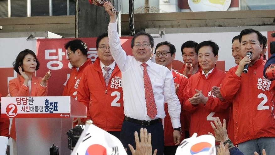 FILE, in this May 5, 2017 file photo, South Korean presidential candidate Hong Joon-pyo of the Liberty Korea Party waves during a presidential election campaign in Seoul, South Korea. South Korean opinion polls suggest that the fall of Park Geun-hye, the country's ousted president who now awaits a corruption trial in jail, has doomed the chances of conservatives in next week's presidential election. But if a conservative does pull off an upset on Tuesday, it's likely to be Hong, the loudmouth former governor. (AP Photo/Ahn Young-joon, File)