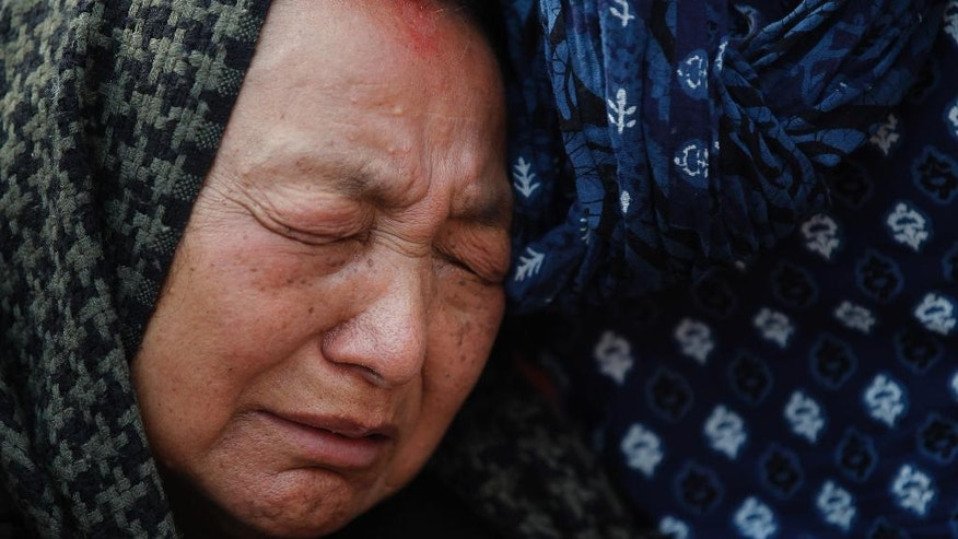 Purna Kumari Sherchan, wife of Nepalese climber Min Bahadur Sherchan cries during her husband's funeral in Kathmandu, Nepal, Sunday, May 7, 2017. The 85-year-old Nepali man died while attempting to regain his title as the oldest person to climb Mount Everest, officials said. Sherchan died at the Everest base camp on Saturday evening. (AP Photo/Niranjan Shrestha)