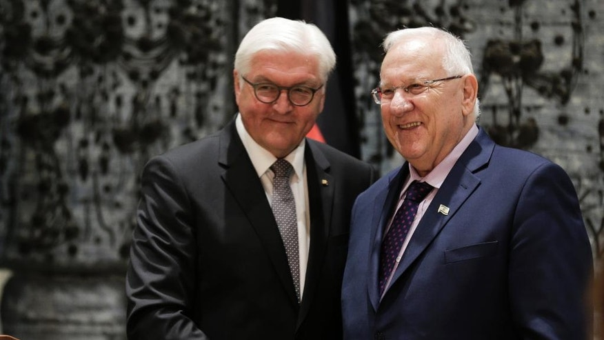 Israeli President Rueven Rivlin, right, and his German counterpart Frank-Walter Steinmeier shake hands in Jerusalem, Sunday, May 7, 2017. (AP Photo/Dusan Vranic)