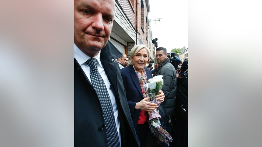 French far-right presidential candidate, Marine Le Pen leaves Henin Beaumont, France, on her way back to Paris after casting her ballot Sunday, May 7, 2017. Voters across France are choosing a new president in an unusually tense and important election that could decide Europe's future, making a stark choice between pro-business progressive Emmanuel Macron and far-right populist Marine Le Pen. (AP Photo/Michel Spingler)