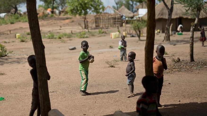 In this photo taken Thursday March 30, 2017, South Sudanese children play in the Bidi Bidi refugee settlement in northern Uganda. More than 1 million children have fled South Sudan's civil war, two United Nations agencies said Monday May 8, 2017, as part of the world's fastest growing refugee crisis. Another 1 million South Sudanese children are displaced within the country said the U.N.'s child and refugee agencies. (AP Photo/Jerome Delay)