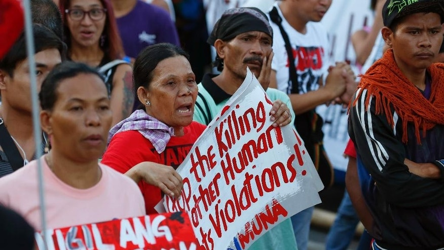 "Protesters shout slogans during a rally near the Presidential Palace to protest the ""extrajudicial killings"" under President Rodrigo Duterte's so-called war on drugs which coincided with the U.N. Human Rights Council Universal Periodic Review in Geneva, Switzerland, Monday, May 8, 2017 in Manila, Philippines. Filipino Senator Alan Peter Cayetano briskly defended the human rights record of Duterte's government before the U.N. body in Geneva on Monday, saying his government always ""seeks to uphold the rule of law"" while critical Western nations aired concerns about deadly vigilante justice and extrajudicial killings in the country. (AP Photo/Bullit Marquez)"