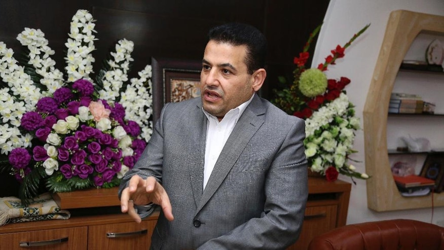 In this Saturday, May. 6, 2017 photo, Iraqi Interior Minister Qasim al-Araji speaks during an interview with The Associated Press, in Baghdad, Iraq. Just over 10 years ago, al-Araji was being arrested for the second time by American forces in Iraq. The charges were serious: smuggling arms used to attack U.S. troops and involvement in an assassination cell at the height of sectarian violence that engulfed Iraq following the 2003 toppling of Saddam Hussein. Now, he heads of one of Iraq's most powerful ministries. (AP Photo/Karim Kadim)