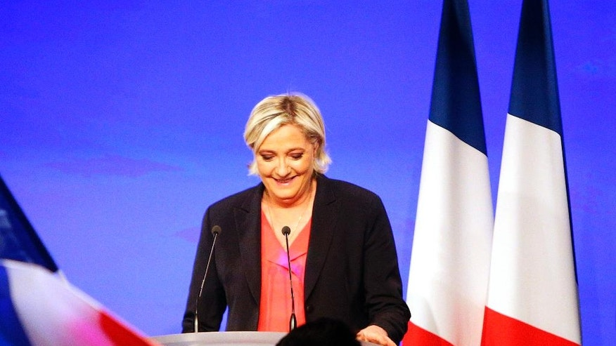 French far-right presidential candidate Marine le Pen delivers a speech, Sunday, May 7, 2017 in Paris. French voters elected centrist Emmanuel Macron as the country's youngest president ever on Sunday, delivering a resounding victory to the unabashedly pro-European former investment banker and strengthening France's place as a central pillar of the European Union. (AP Photo/Michel Spingler)