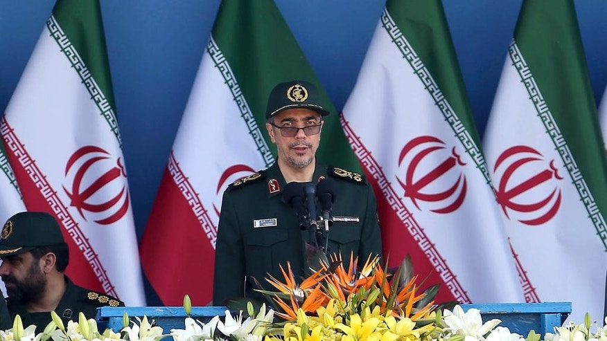 FILE -- In this Sept. 21, 2016 file photo, Chief of Staff of Iran's Armed Forces, General Mohammad Hossein Bagheri delivers a speech during a military parade marking the 36th anniversary of Iraq's 1980 invasion of Iran, in front of the shrine of late revolutionary founder Ayatollah Khomeini, just outside Tehran, Iran. State television on Monday, May 8, 2017, quoted Bagheri as saying soldiers will attack terrorists wherever they are, suggesting they could go over the border into Pakistan to target militants there. The report comes after an attack claimed by the Sunni militant group Jaish-ul-Adl killed 10 soldiers in April. (AP Photo/Ebrahim Noroozi, File)