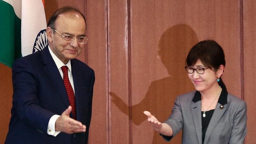 Indian Defense Minister Arun Jaitley, left, is greeted by his Japanese counterpart Tomomi Inada prior to their meeting at Defense Ministry in Tokyo, Monday, May 8, 2017. (AP Photo/Shizuo Kambayashi)