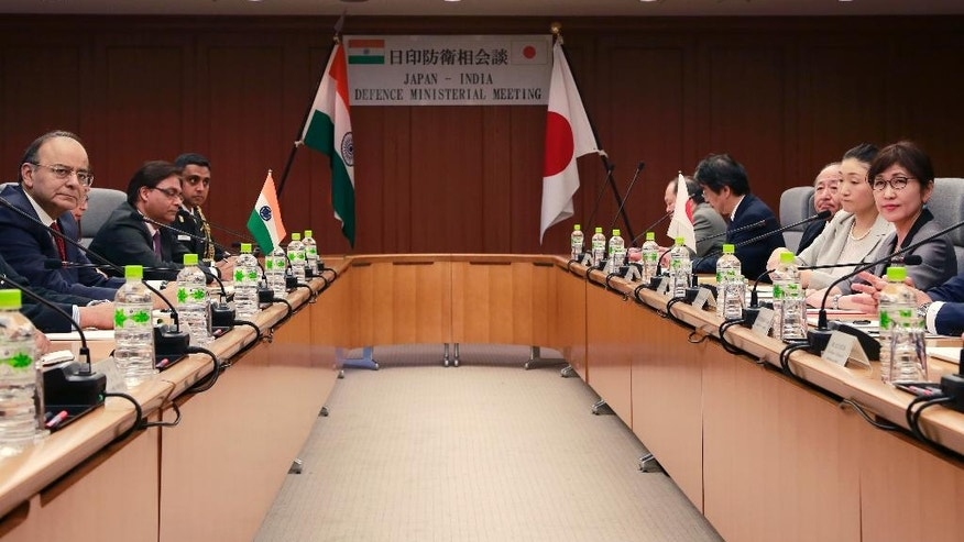 Indian Defense Minister Arun Jaitley, left, and his Japanese counterpart Tomomi Inada, right, pose for photos at the start of their meeting at Defense Ministry in Tokyo, Monday, May 8, 2017. (AP Photo/Shizuo Kambayashi)