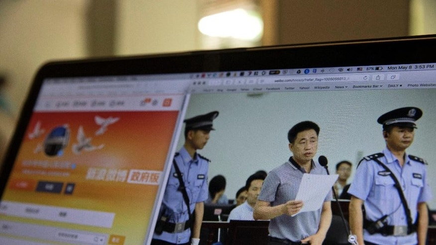 A photo described as the trial showing human rights lawyer Xie Yang which is seen on the social media of the Changshai Intermediate People's Court is displayed on a computer in Beijing, China, Monday, May 8, 2017. Human rights lawyer Xie Yang has told a Chinese court that he wasn't forced into confessing to crimes after being detained in a large government crackdown on the country's legal professionals. (AP Photo/Ng Han Guan)