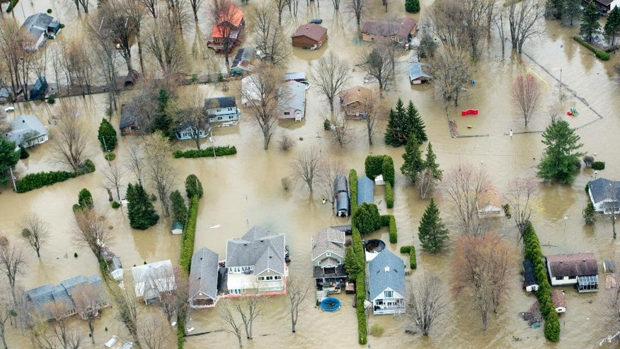 In this aerial photo, flooded homes are seen in Rigaud, Quebec, Monday, May 8, 2017. (Paul Chiasson/The Canadian Press via AP)