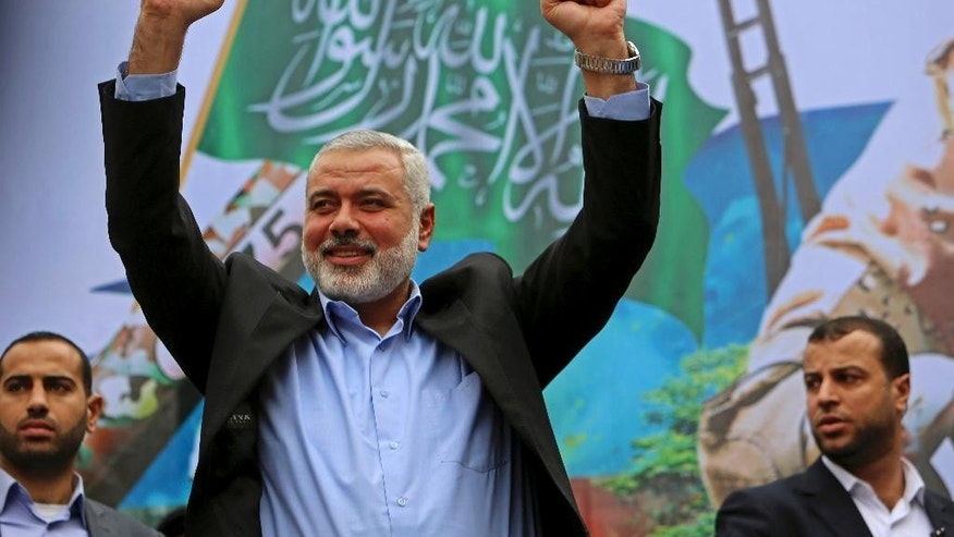 File - In this Friday, Dec. 12, 2014 file photo, Hamas leader Ismail Haniyeh greets supporters during a rally to commemorate the 27th anniversary of the Hamas militant group in Jebaliya in the northern Gaza Strip. Hamas is confirming that its former Gaza prime minister Ismail Haniyeh has been chosen as the Islamic militant group's top leader. Hamas spokesman said Haniyeh was picked Saturday May 6, 2017 as Hamas politburo chief. He replaces Khaled Mashaal, its longtime leader. (AP Photo/Adel Hana, File)