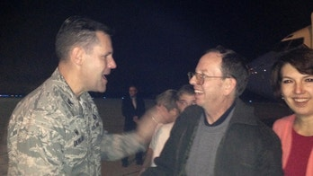 Jeffrey Fowle (C) and his wife Tatyana (R), are greeted by U.S. Air Force 88 Air Base Wing Commander Col. John Devillier upon arrival at Wright-Patterson Air Force Base in Ohio early October 22, 2014. Fowle has returned to his home in southern Ohio after his release from North Korea, where he was treated well while in captivity, his lawyer said on Wednesday.   