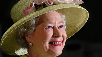 FILE - In this May 8, 2007 file photo, Britain's Queen Elizabeth II smiles as she is greeted by astronauts aboard the International Space Station, via video conference, during her visit to NASA's Goddard Flight Center in Greenbelt, Md..  On Monday Feb. 6, 2017, Queen Elizabeth II marks her Sapphire Jubilee, becoming the first British monarch to reign for 65 years. (AP Photo/J. Scott Applewhite, File)