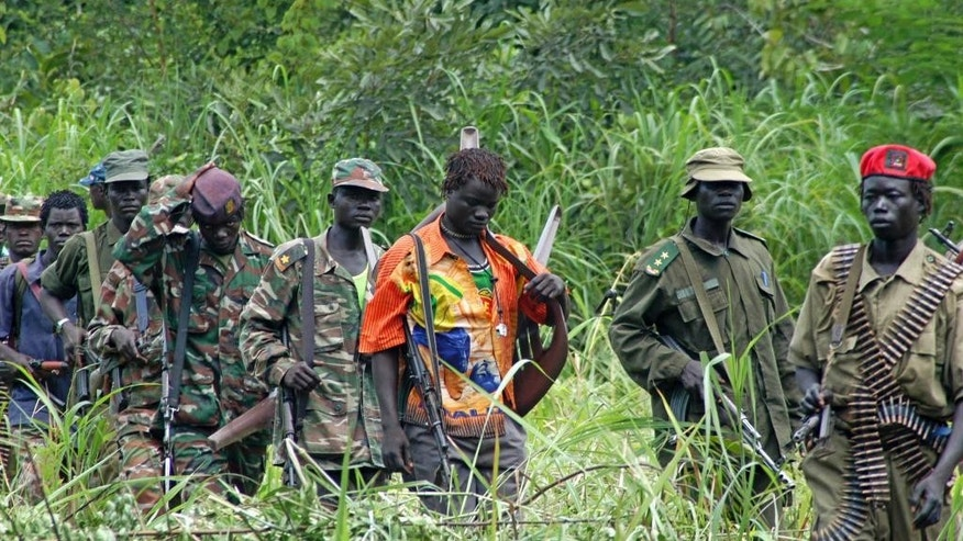 FILE - In this July 31, 2006 file photo, members of Uganda's Lord's Resistance Army (LRA) are seen as their leader Joseph Kony meets with a delegation of Ugandan officials and lawmakers and representatives from non-governmental organizations, in the Democratic Republic of Congo near the Sudanese border. Kony has been Africa's most notorious warlord for three decades. Now that the United States and others are ending the international manhunt for him and his Lord's Resistance Army, it appears Kony may never be brought to justice. (AP Photo, File)
