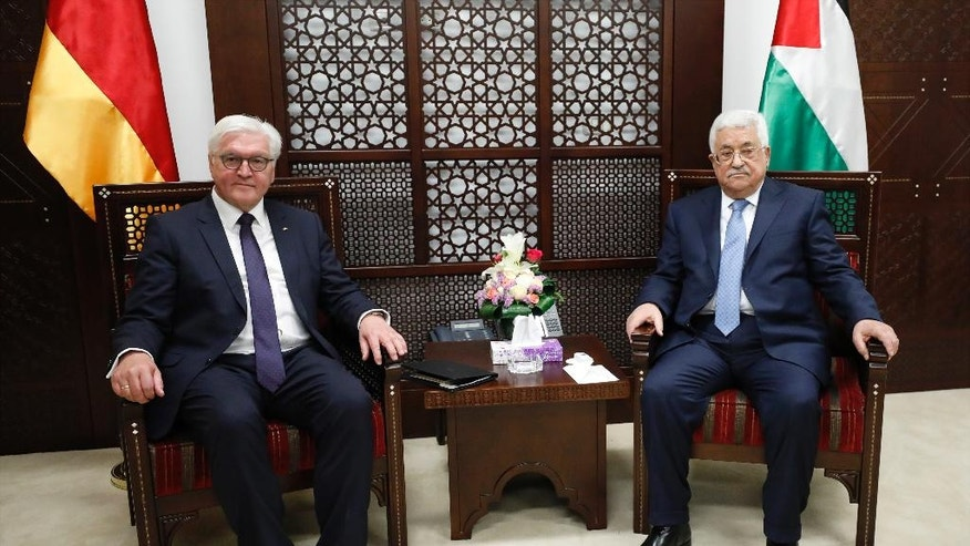 Palestinian President Mahmoud Abbas, right, meets with German President Frank-Walter Steinmeier in the West Bank city of Ramallah, Tuesday, May 9, 2017. (Mohamad Torokman/Pool Photo via AP)
