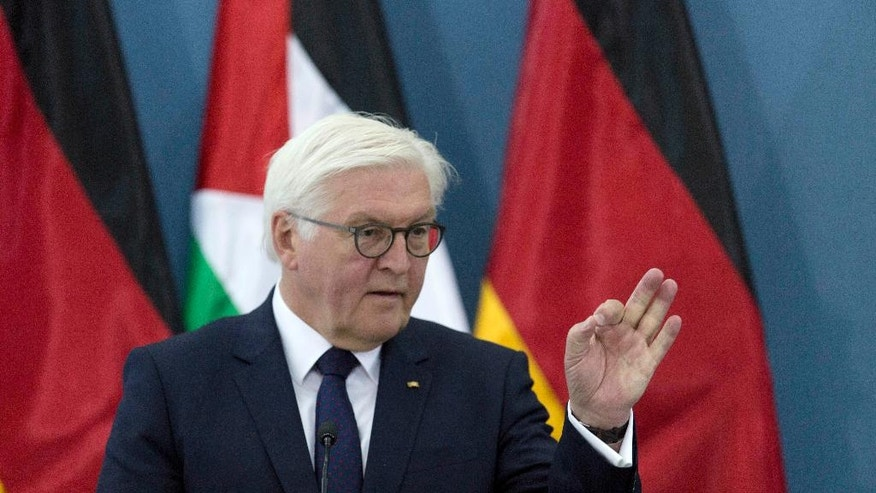 German President Frank-Walter Steinmeier speaks during a joint press conference with Palestinian President Mahmoud Abbas following their meeting, in the West Bank city of Ramallah, Tuesday, May 9, 2017. (AP Photo/Nasser Nasser)