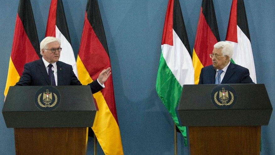 German President Frank-Walter Steinmeier, left, speaks during a joint press conference with Palestinian President Mahmoud Abbas following their meeting, in the West Bank city of Ramallah, Tuesday, May 9, 2017. (AP Photo/Nasser Nasser)