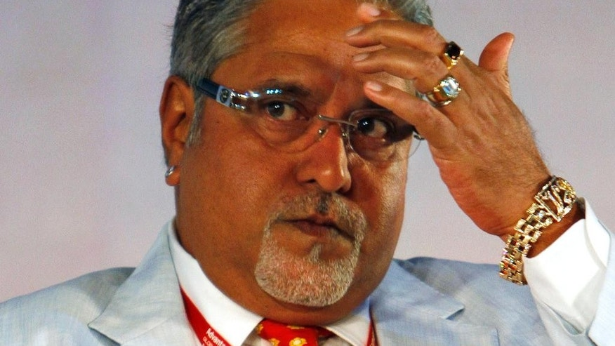 In this June 3, 2010 file photo, United Breweries Group Chairman Vijay Mallya attends the Global Investors Meet organized by Karnataka state government in Bangalore, India. India's top court on Tuesday, May 9, 2017, found wanted tycoon Mallya guilty of disobeying its order barring him from transferring $40 million to his children. Mallya, who fled to London last year, is wanted in India on charges of money laundering and bank demands that he pay back more than a billion dollars in loans extended to his now-defunct airline. India has been seeking his extradition over the charges, which Mallya denies.(AP Photo/Aijaz Rahi, File)