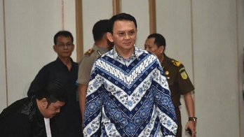 "Jakarta Governor Basuki ""Ahok"" Tjahaja Purnama, center, enters the court room as he attends his sentencing hearing in Jakarta, Indonesia, Tuesday, May 9, 2017. The minority Christian governor is currently on trial on accusation of blasphemy following his remark about a passage in the Quran that could be interpreted as prohibiting Muslims from accepting non-Muslims as leaders. (Bay Ismoyo/Pool Photo via AP)"