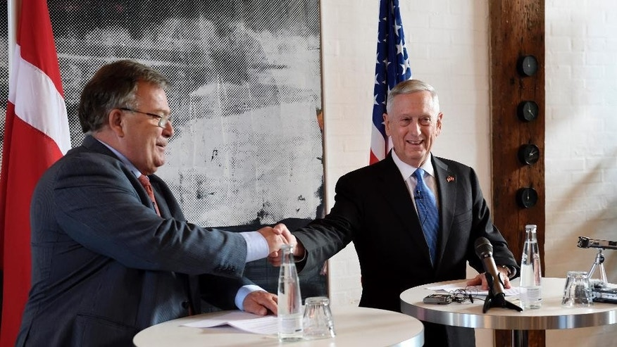 US Secretary of Defense Jim Mattis, right, shakes hands with Danish Defense Minister Claus Hjort Frederiksen,  during a press conference, in Copenhagen, Denmark, Tuesday, May 9, 2017. Mattis said he had open and useful discussions with Turkish officials Tuesday, and said the two countries are working out differences over America's continuing support for Syria Kurds as the fight against Islamic State militants moves closer to group's headquarters in Raqqa. (Stine Tidsvilde/Ritzau Foto via AP)